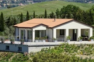 Realizzazione Casa in Legno Casa Bibbona di Vibrobloc S.p.A.
