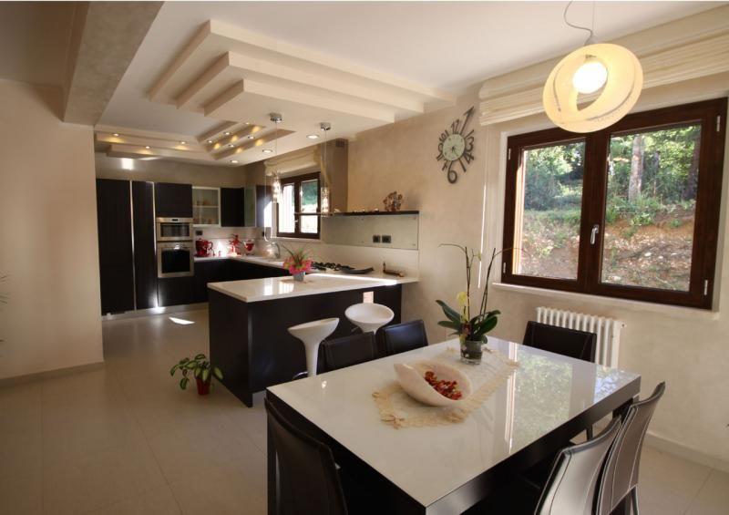 Casa in legno modello l 39 aquila di costantini legno l a cost for Progetti interni case