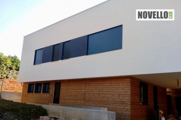 Realizzazione Casa in Legno Villa in legno stile moderno di Novellocase Srl