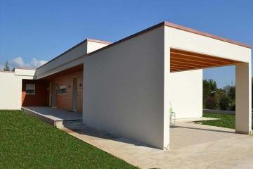 Realizzazione Casa in Legno Abitazione Tezze sul Brenta di HEMMA CASA