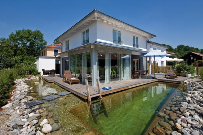 Casa in legno modello casa traunstein di design haus italia for Haus case in legno
