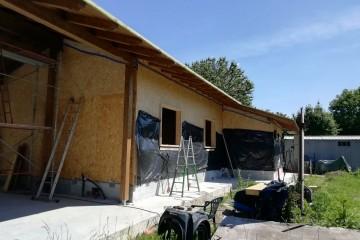 Realizzazione Casa in Legno Casa a Milano in  Legno Lamellare cert. FSC - PEFC a Telaio (Timber Frame) di BCL Bergamasca Costruzioni Legno