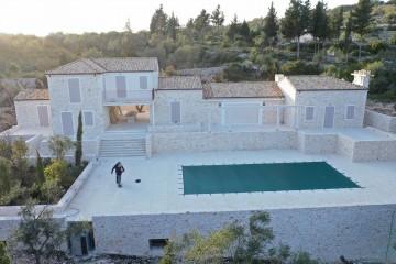 Realizzazione Casa in Legno Al Paxos di Architettura Lamellare srl