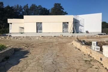 Realizzazione Casa in Legno Abitazione Lecce di KOSTRUIRE - Sostenibilità e innovazioni abitative