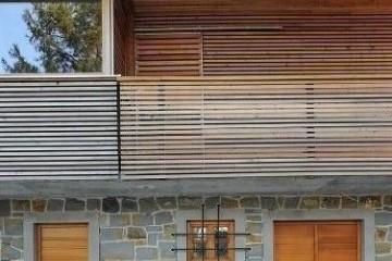 Realizzazione Casa in Legno Casa con facciate in Pietra  a due piani di RIKO-HISE srl - Arch. Daniele Bonzi