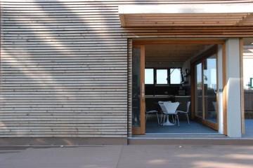 Realizzazione Casa in Legno Casa monovolume moderna di RIKO-HISE srl - Arch. Daniele Bonzi