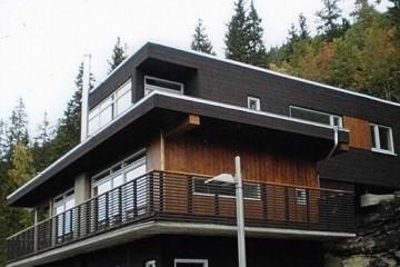 Realizzazione Casa in Legno VILLA SUL LAGO ( svizzera ) di RIKO-HISE srl - Arch. Daniele Bonzi